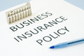 Business insurance policy on blue background Royalty Free Stock Photos