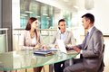 Business interaction group of three partners interacting at meeting in office Royalty Free Stock Photo