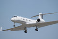 Business jet a smart looking white coming in for landing Stock Images