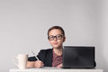 Business kid in suit and glasses at the work place Royalty Free Stock Photo
