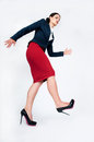 Business lady goes purposeful gait most woman ridiculous and waving hands Royalty Free Stock Photography