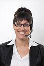 Business lady with a headset Royalty Free Stock Photo