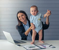 Business lady with her baby Royalty Free Stock Photo