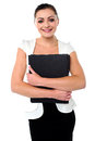 Business lady holding office files female executive posing with company records Stock Photography