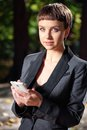 Business lady with mobile phone. Royalty Free Stock Photo