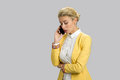 Business lady talking on cell phone. Royalty Free Stock Photo