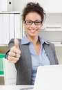 Business lady thumbs up gesturing yes to you Royalty Free Stock Photography