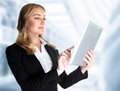 Business lady with touch pad closeup portrait of beautiful confident working in the office modern technology successful career Stock Image