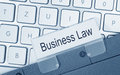 Business Law - folder with text on computer keyboard Royalty Free Stock Photo