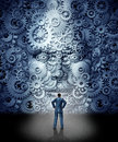 Business leadership training concept as a businessman facing a huge human head made from gears and cog wheels connected together Royalty Free Stock Photography