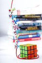 Business letter pieces on a string white forming the word clipped red intertwined rubik s cube with blurred books Royalty Free Stock Photography