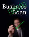 Business loan an underwriter writing approved on a screen Stock Image