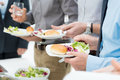 Business lunch detail closeup of people s hands having together Royalty Free Stock Photography