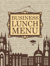Business lunch inscription in a picture frame on the background of the old town Stock Image