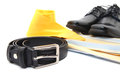 Business or male accessories belt shoes yellow shirt and yellow tie on white Stock Image