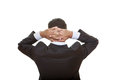 Business man back view thinking hands clenched behind head Royalty Free Stock Photos