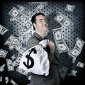 Business man in bank vault with finance money bag Royalty Free Stock Photo