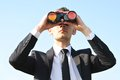Business man with binoculars Royalty Free Stock Photo