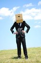 Business man with box on head Stock Photos