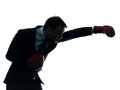 Business man boxer with boxing gloves  silhouette Royalty Free Stock Photography
