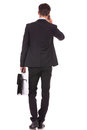 Business man with briefcase talking on  smartphone Royalty Free Stock Photos