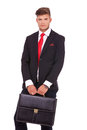 Business man with briefcase young holding a both of his hands and looking at the camera a serious look on his face isolated Stock Image