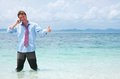 Business man calling by cell phone on the beach Royalty Free Stock Photo