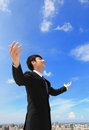 Business man carefree outstretched arms with sky and cloud asian people Stock Photo