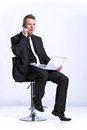 Business man on cell phone in front of laptop Royalty Free Stock Photography
