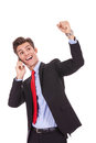 Business man on a cell phone and winning Royalty Free Stock Images