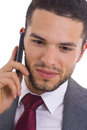 Business man with cellphone young handsome executive talking to a Royalty Free Stock Images