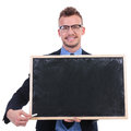 Business man with chalk and blackboard young presenting a a piece of while smiling for the camera on white background Royalty Free Stock Images