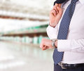 Business man checking time on his wristwatch Royalty Free Stock Photo