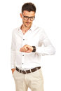 Business man checking wristwatch time and looking to on his hand isolated on white background Stock Photography