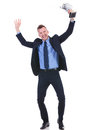 Business man cheers with trophy full length picture of a young cheering while holding a in his hand on white background Stock Photography