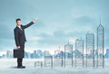 Business man climbing up on hand drawn buildings in city concept Royalty Free Stock Photos