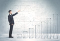 Business man climbing up on hand drawn graphs concept background Royalty Free Stock Photo