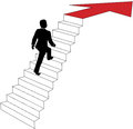 Business man climbs up arrow stairs Stock Photo
