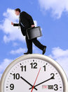 Business Man on Clock Stock Images