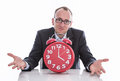 Business man with clock time is running out Stock Image