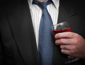 Business man closeup view of inebriated in suit and tie holding wine glass Stock Photos