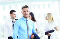 Business man with colleagues at the back handsome happy men Royalty Free Stock Images