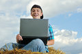 A business man in a countryside with a laptop Royalty Free Stock Photography
