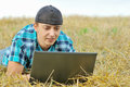 A business man in a countryside with a laptop Stock Image
