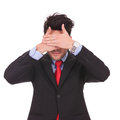 Business man covers his eyes Royalty Free Stock Photos