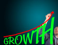 Business man drawing curve of growth Royalty Free Stock Photo