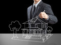 Business man drawing dream house on screen Royalty Free Stock Photo