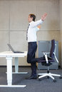 Business man exercises in office Royalty Free Stock Photo