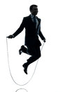 Business man exercising jumping rope silhouette one businessman in studio isolated on white background Royalty Free Stock Photo