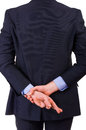Business man with fingers crossed Royalty Free Stock Photo